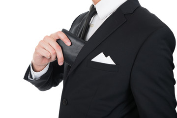 Businessman Putting Wallet In His Pocket