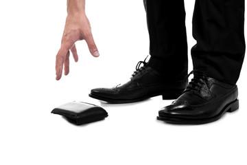 Businessman Picking Up Fallen Wallet