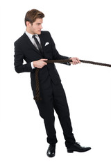 Side View Of Businessman Pulling Rope