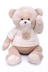 Cute teddy bear waving his paw