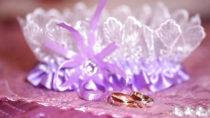 beautiful golden rings and garter on the table