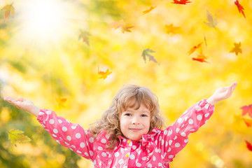 Child in autumn park