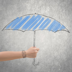 concept of waterproof by holding a umbrella