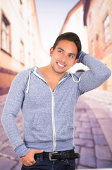 handsome latin man wearing a hoodie posing