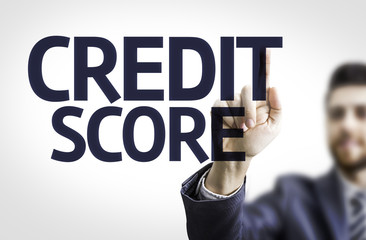 Business man pointing the text: Credit Score