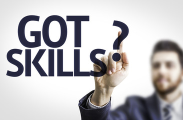 Business man pointing the text: Got Skills?