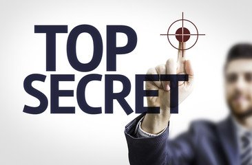 Business man pointing the text: Top Secret