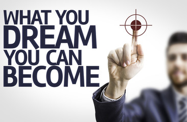 Business man pointing: What You Dream You Can Become