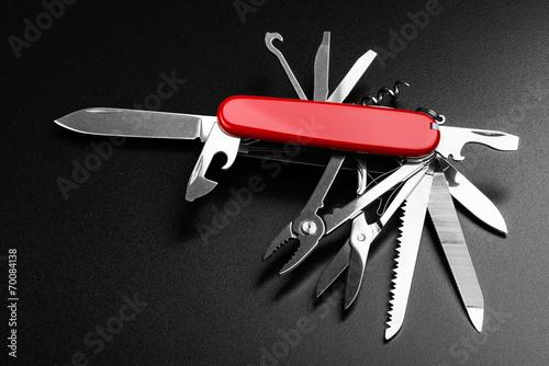 Leinwanddruck Bild Pocket Swiss knife fully opened