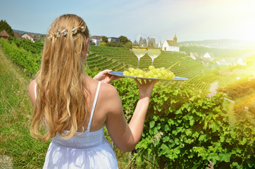 Wineglass against vineyards in Rheinau, Switzerland