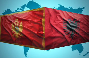 Waving Montenegrin and Albanian flags