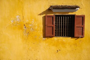 opened-window on yellow wall