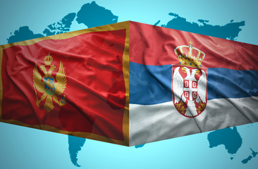 Waving Montenegrin and Serbian flags