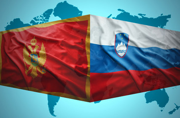 Waving Montenegrin and Slovenian flags
