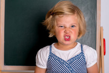 angry girl in front of black board