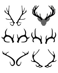Black silhouettes of horns of deer , vector