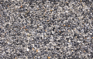 Mosaic of pebbles on wall closeup