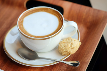 Hot latte and almond cookie