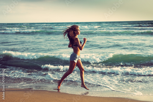 canvas print picture active on beach