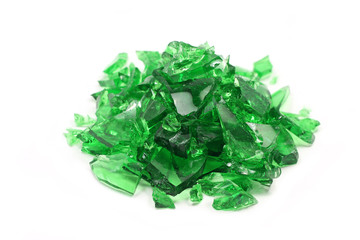 broken pieces of green glass on a white background