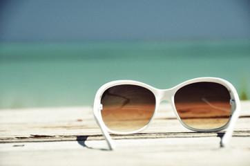 Sunglasses against ocean. Exuma, Bahamas