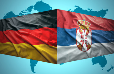 Waving Serbian and German flags