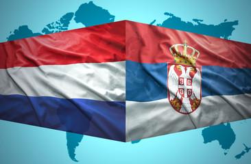 Waving Serbian and Dutch flags