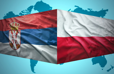Waving Serbian and Polish flags