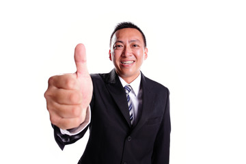 Smile businessman with thumb up