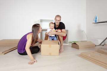 Young Family with a Baby  Moving