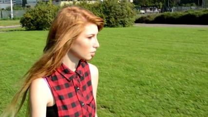 young attractive woman goes in park - nature
