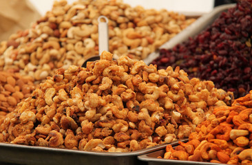 Trays of Prepared Nuts on a Food Retail Stall.
