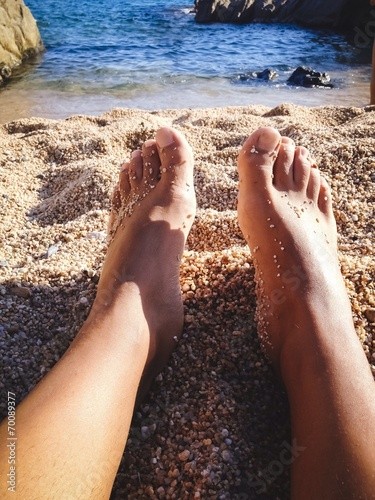 canvas print picture feet along the seashore