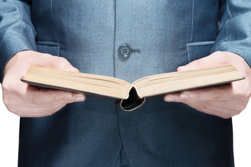 man in a suit holding an open book