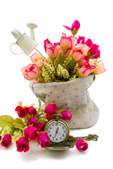 Roses in fabric sack with pocket watch aside as timeless love co