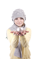 lovely girl in a gray hat holding a Christmas candlestick
