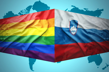 Waving Slovenian and Gay flags