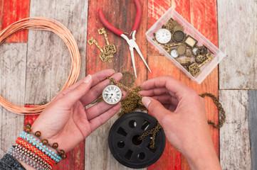 making craft jewellery on wood background