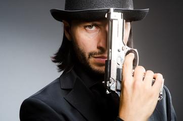 Man wearing vintage hat with gun