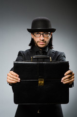 Businessman wearing vintage concept with briefcase