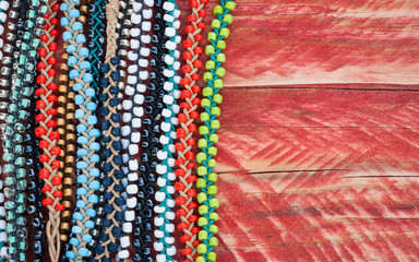 colourful bead bracelets on grungy wood background