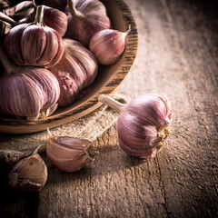 garlic bulb on rustic wooden background