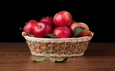 many apples in the basket on the wood desk