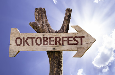 Oktoberfest wooden sign on a beautiful day