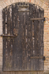 old door of wood in Castle of Gradara