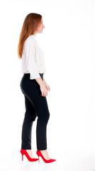 walking redhead business woman.
