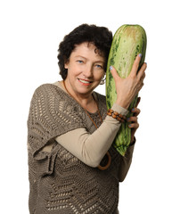 Woman holding big courgette (zucchini)