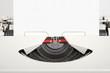 Travel typewriter with squared sheet.