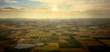 Aerial Sun on the Horizon over Farmland