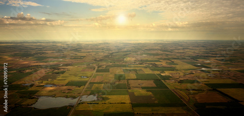 Plexiglas Luchtfoto Aerial Sun on the Horizon over Farmland
